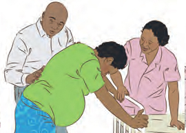 Parents helping pregnant person
